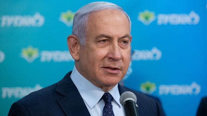 Israeli Prime Minister Netanyahu attends a ceremony marking the 4,000,000th person to be vaccinated at Leumit Health Care Services vaccination facility in Jerusalem on February 16, 2021. Israel's largest healthcare provider said a study of more than half a million fully vaccinated Israelis indicated the Pfizer/BioNTech jab gave 94 percent protection against Covid-19. Alex KOLOMIENSKY / POOL / AFP