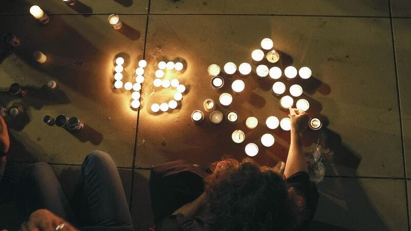 People light candles during a vigil in Habima Square in the Israeli coastal city of Tel Aviv