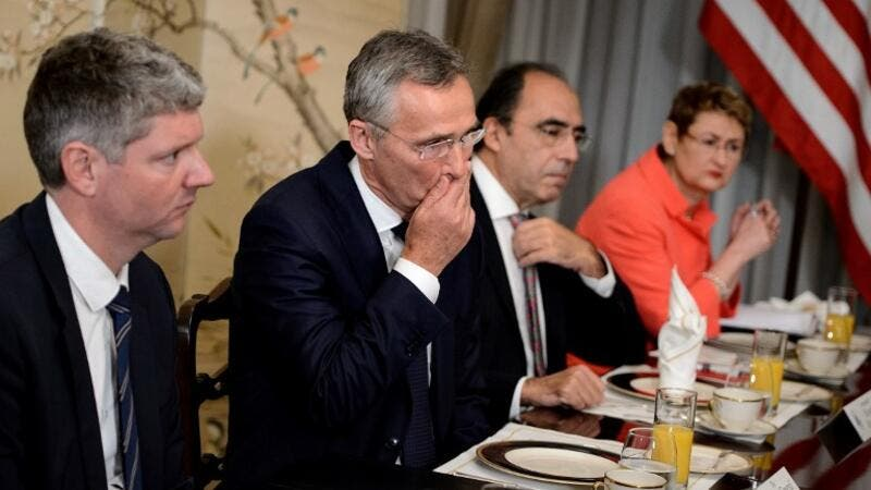 NATO Secretary General Jens Stoltenberg (2L) gestures before a breakfast meeting with the US president at the US chief of mission's residence in Brussels on July 11, 2018, ahead of a NATO (North Atlantic Treaty Organization) summit. 
