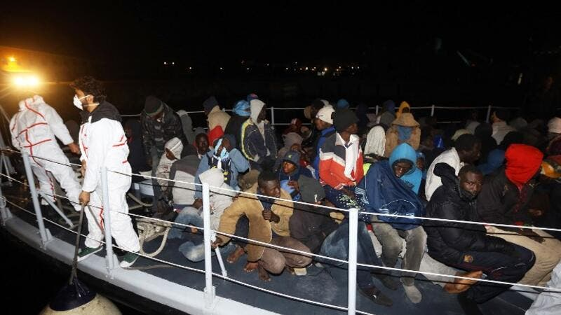 Illegal migrants from Arab and African nationalities arrive at a naval base in the capital Tripoli late on Jan. 15, 2018, after they were rescued off the coast of Zuwara, 130 kilometers (81 miles) West of the Libyan capital (Mahmud TURKIA / AFP)