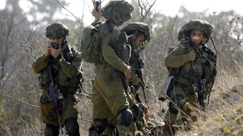 Israeli soldiers patrolling along the Israeli border (AFP/File Photo)
