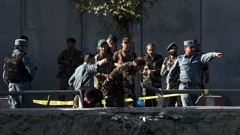 Afghan security personnel investigate the site of a twin suicide bombing near the Ministry of Defense in Kabul on September 5, 2016. The death toll from a Taliban double suicide bombing in the Afghan capital Kabul jumped to 24 with 91 wounded, the health ministry said. (AFP/Wakil Kohsar)