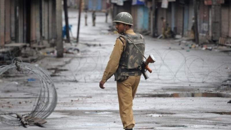 Soldier walks aside barbed wire in Kashmir (AFP/ File Photo)