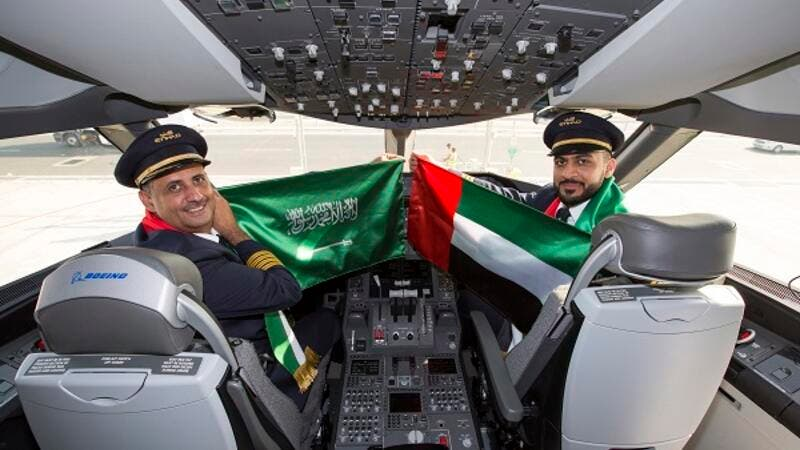 Etihad Airways Captain Mohammed Awadh Alanzi, a Saudi National and First Officer Mansoor Mohamed Al Hammadi, Emirati, celebrate Saudi Arabia National Day.