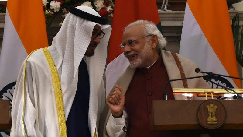 Indian Prime Minister Narendra Modi (R) shares a light moment with Abu Dhabi's Crown Prince Sheikh Mohammed bin Zayed al-Nahyan at Hyderabad House in New Delhi on February 11, 2016. (AFP/Money Sharma)