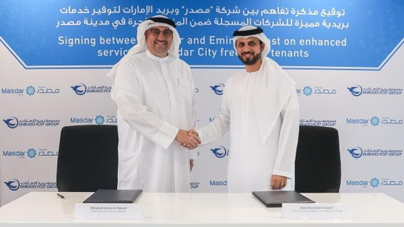 Mohamed Jameel Al Ramahi, Masdar's Chief Executive Officer, and Obaid Mohammad Al Qatami, Acting Chief Commercial Officer at Emirates Post Group, signed the agreement.