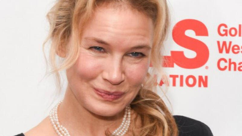 Zellweger had her long blonde locks parted in the middle and down, and was impeccably made up. (source: PRESLEY ANN  GETTY IMAGES NORTH AMERICA  AFP)