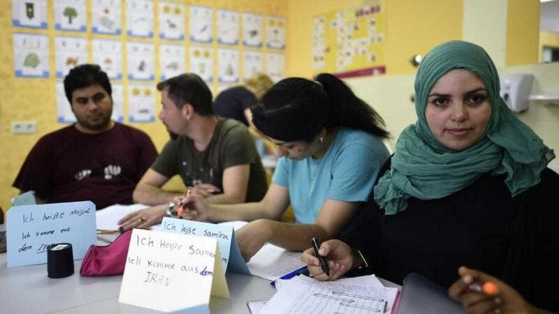 Refugees attend a German course in a classroom at a temporary home providing assistance for refugees in Berlin's Gatow district. (AFP/ TOBIAS SCHWARZ)