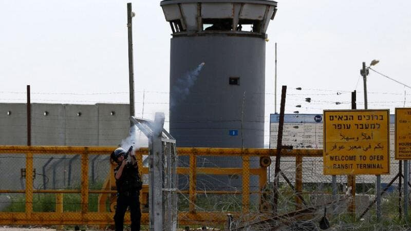 A file photo of Israeli security forces firing tear gas at protesters outside of Ofer prison. (AFP/File)