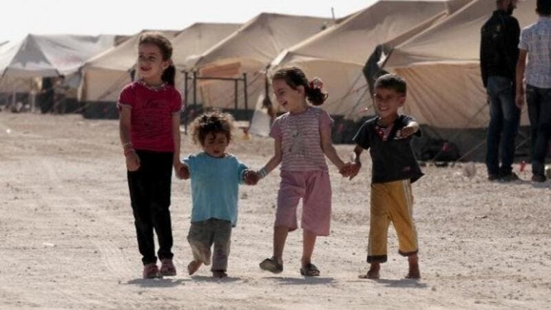 Refugee children walk among tents at the Zaatri refugee camp, near the Jordanian border with Syria. (AFP/ File)