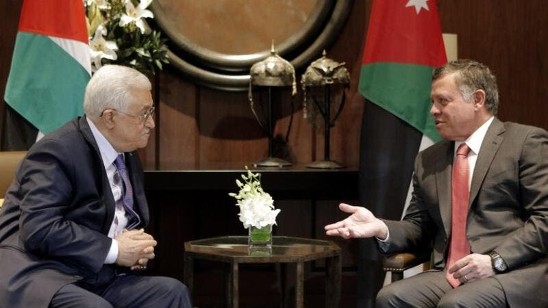King Abdullah and Palestinian President Mahmoud Abbas met and discussed the latest developments in the Palestinian issue. (AFP/ File Photo)