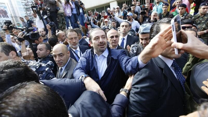 Former Lebanese Prime Minister Hariri takes a selfie with voters outside of a polling station. (AFP/Anwar Amro)