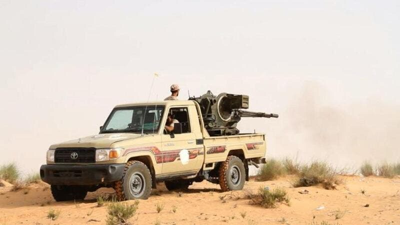 Fighters from the Libya Dawn militia fire at positions of forces loyal to Libya's internationally recognized government. (AFP/ File)
