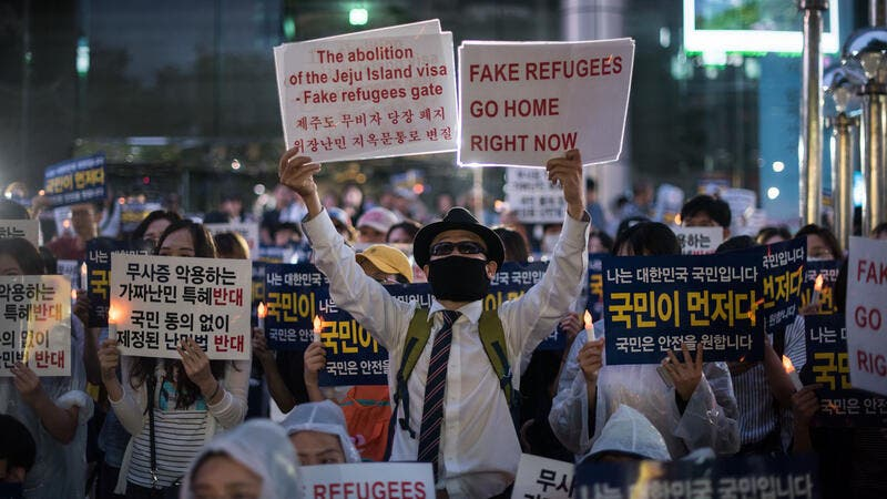 S. Koreans have been seen protesting against their government's policy toward Yemeni refugees. (AFP)