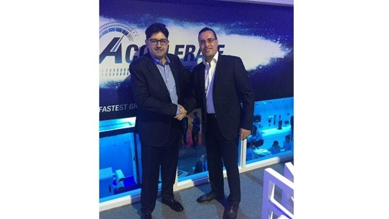 Mahmoud Nimer, General Manager at StarLink, shaking hands with Kamel Heus, Regional Manager MEA at Centrify.