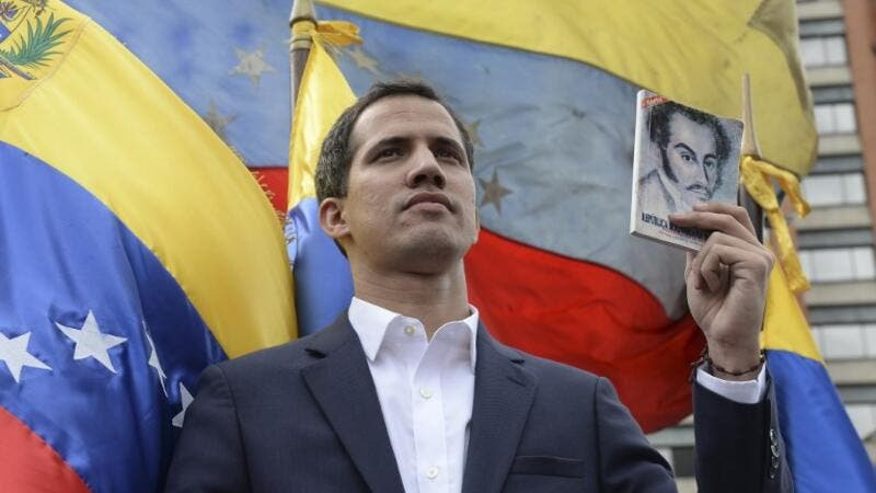 "Venezuela's National Assembly head Juan Guaido declares himself the country's ""acting president"" during a mass opposition rally against leader Nicolas Maduro. (AFP/ File)"