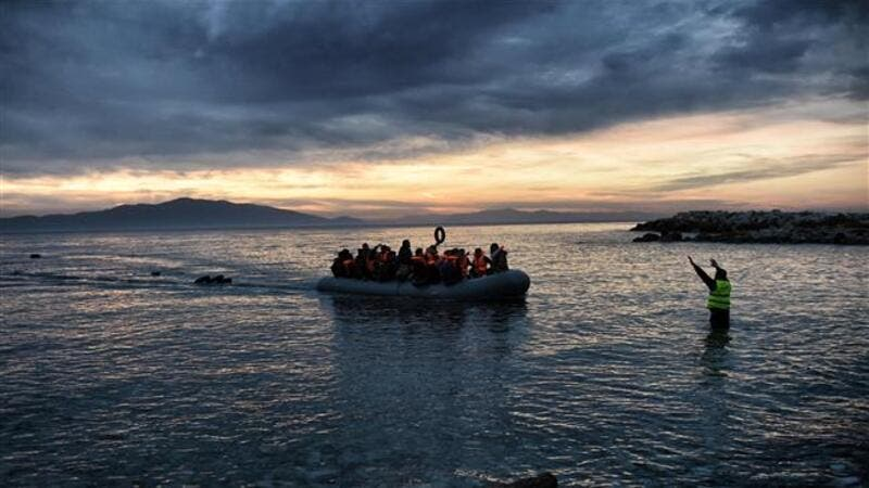 This photo taken on February 17, 2016 shows refugees massed onto an inflatable boat reaching Mytilene, northern Greek island of Lesbos, after crossing the Aegean sea from Turkey. (AFP/File)