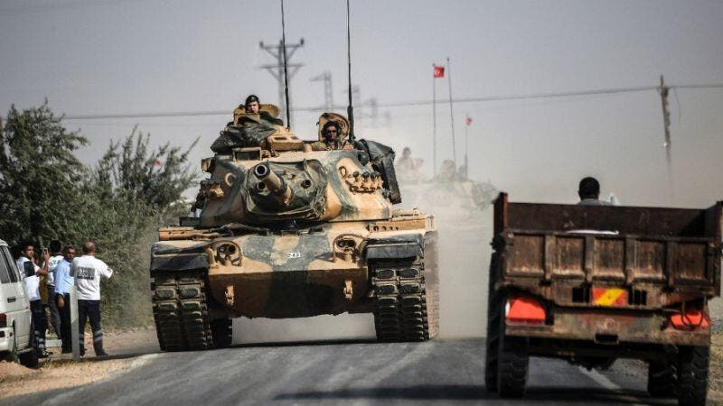 "A Turkish tank heads towards the Syria border as Turkey launched operation ""Euphrates Shield"" aimed at ridding the area of Daesh extremists. (AFP/Bulent Kilic)"