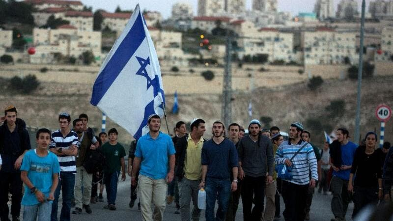 Israelis march from the Jewish settlement of Maale Adumim to the controversial West Bank area known as E1 on February 13, 2014. (AFP/Menahem Kahana)