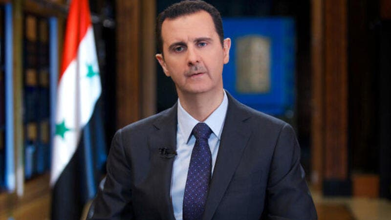 A handout picture released by the official Syrian Arab News Agency (SANA) on September 25, 2013 shows President Bashar al-Assad giving a television interview (Image credit: AFP)
