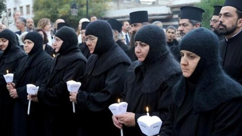 The photo shows Greek Orthodox nuns at the Meriamiah Church in Damascus on December 9, 2012. [alalam]
