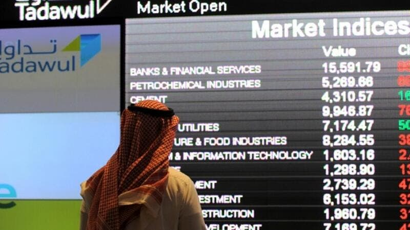 On Wednesday, SAAB and Alawwal Bank topped the hikes of the Saudi Stock Exchange (Tadawul) after their possible merger announcement. (AFP/ Fayez Nureldine)