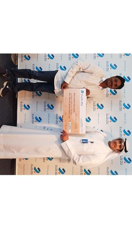 Chandra Sekhar Gembal, winner of the KD4,000 draw, receiving his cheque.