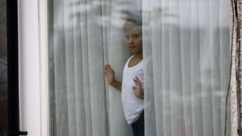 Child looking thru the window (AFP/File Photo)