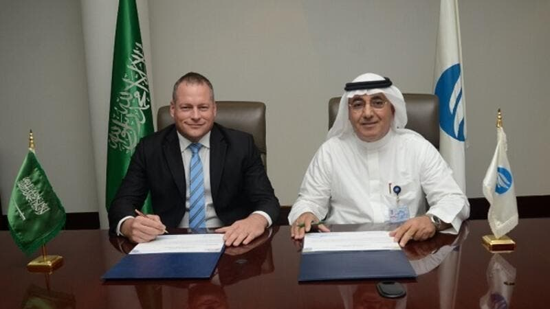 Johan van der Westhuyzen, Regional director for DSS – Turkey, Middle East and Sub-Saharan Africa and His Excellency Ali Al-Hazmi, Governor of SWCC, during the signing ceremony