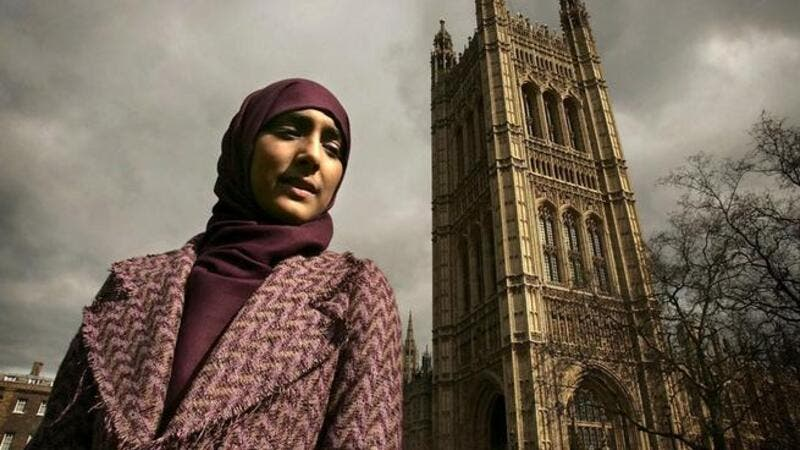 A British Muslim poses outside Westminster