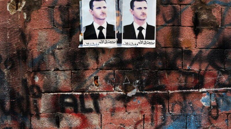 Syrian president Bashar al-Assad's picture hangs on a wall in a poor area of Beirut with a high concentration of Syrian refugees.