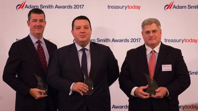 Adam Boukadida, Etihad Aviation Group (EAG) Acting Group Treasurer, pictured centre, flanked by Roger Fleischman, of J.P. Morgan, left, and Michael Guralnick, of Citibank, with some of EAG's Adam Smith awards.