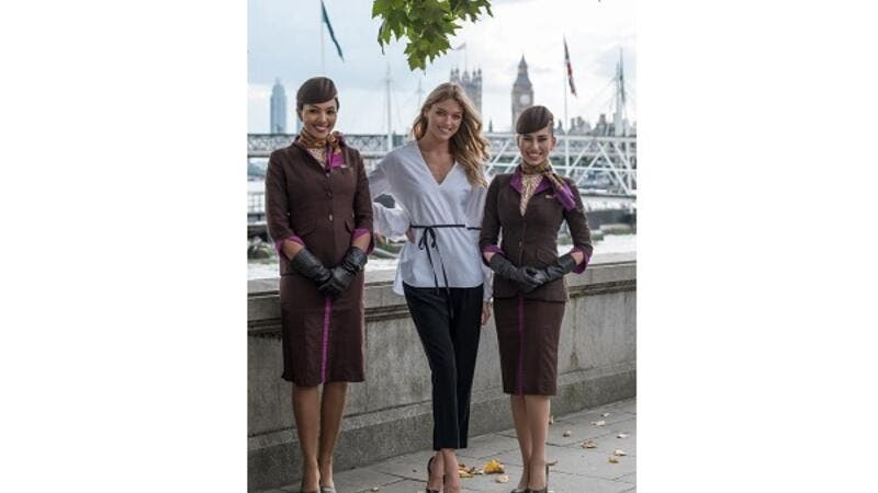 American fashion model Martha Hunt poses in London with members of Etihad Airways' award-winning cabin crew.