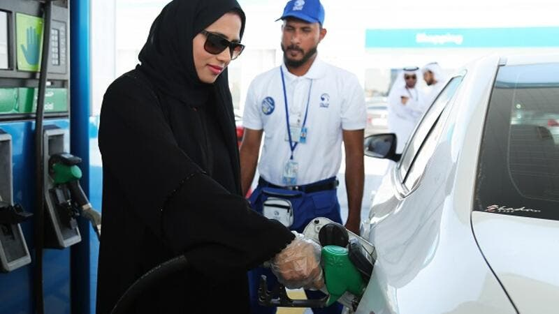 Emirati woman chooses Self Service option at ADNOC service stations.