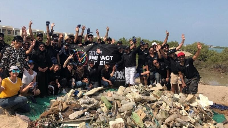 Group Photo During the cleanup at Khor Muzahmi in Mina Al Arab