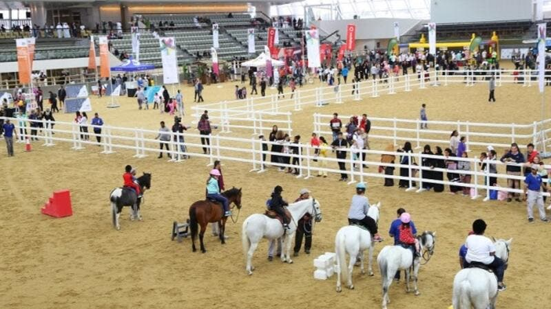Members of the community enjoy pony rides as part of Qatar Foundation's National Sport Day activities.