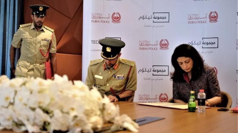 The first of their kind in the region, the smart police stations will offer smart services round-the-clock, including allied services that will operate without any human intervention.  (Pictured here: Major General Abdullah Khalifa Al Marri, Commander-in-Chief of Dubai Police, and Dr. Amina Al Rustamani, Group CEO of TECOM Group.)