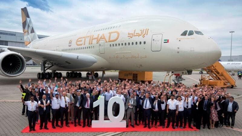 Etihad Airways and Airbus employees celebrate the handover of the airline's 10th and final Airbus A380 at Hamburg Finkenwerder.