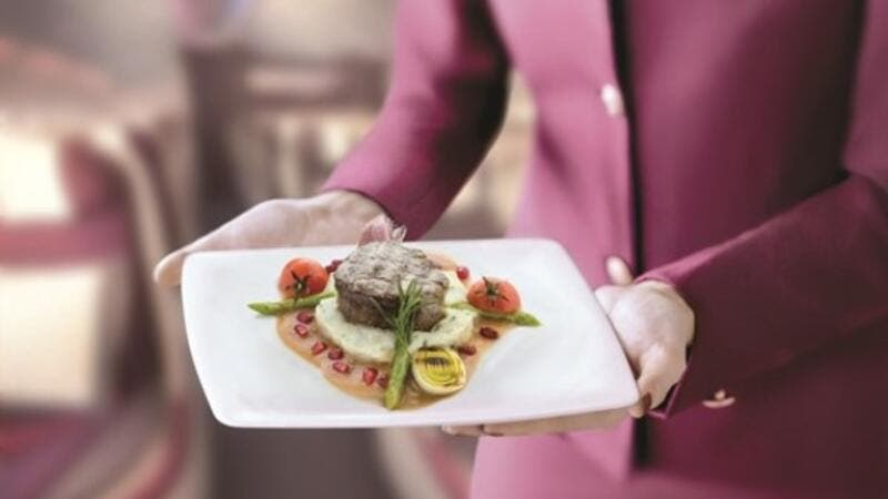 To pre-select a premium class meal, customers must log into 'My Trips' on the QA website and choose from the seasonal menu available on their flight. (Alarab)