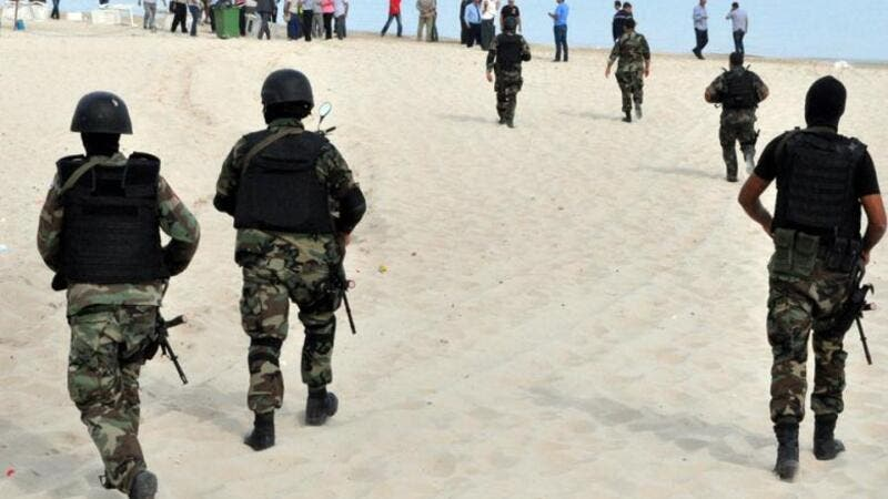 Tunisian security forces inspect a beach after a failed suicide bomb attack near the four-star Riadh Palms hotel, in the resort town of Sousse, on Oct. 30, 2013. (AFP/File)