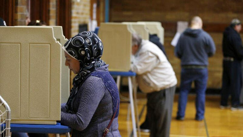 An American Muslim woman votes at the recent election (AFP)
