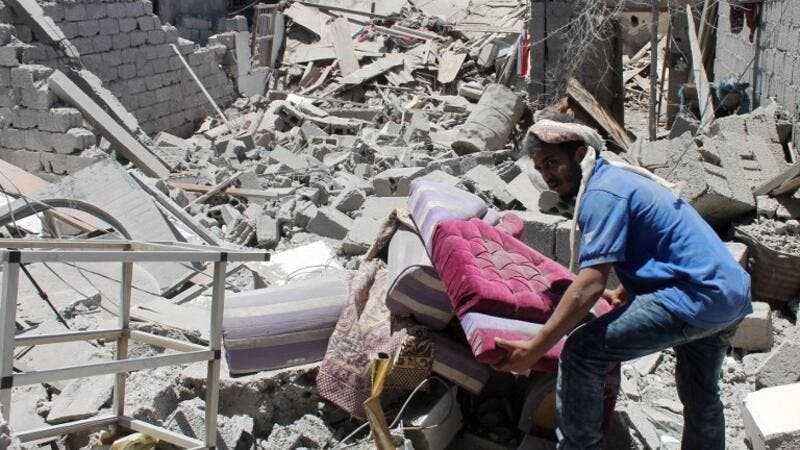 Sorting through rubble caused by Saudi-led coalition airstrikes in Aden. (AFP/Saleh Al Obeidi)