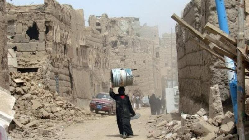 A Yemeni woman walks through a heavily damaged neighborhood in the war-battered city of Saada, March 8, 2015. (AFP/File)