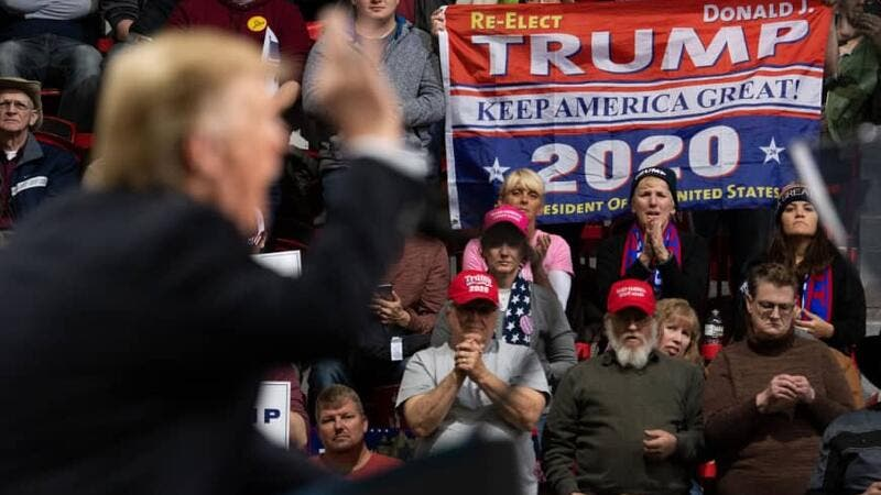 Supporters listen as U.S. President Donald Trump speaks during a Make America Great Again rally in Green Bay, Wisconsin, Saturday. (AFP-JIJI)
