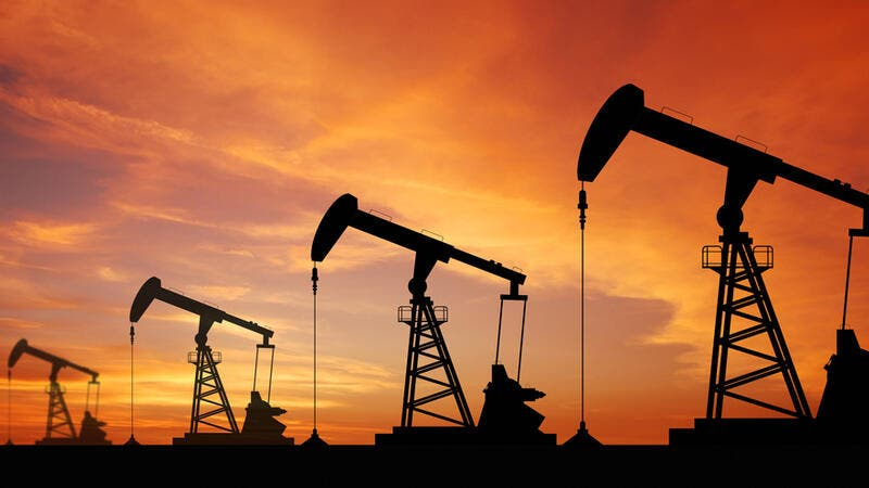 Oil prices jump as producers cut output