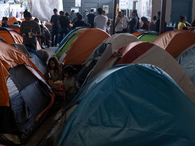 Migrants seeking for asylum in the United States are seen in Juventud 2000 migrant shelter in Tijuana, Baja California state, on June 19, 2019, Mexico ahead of World Refugees Day. World Refugee Day is observed June 20 each year internationally to raise awareness of the situation of refugees throughout the world.  (Guillermo Arias / AFP)