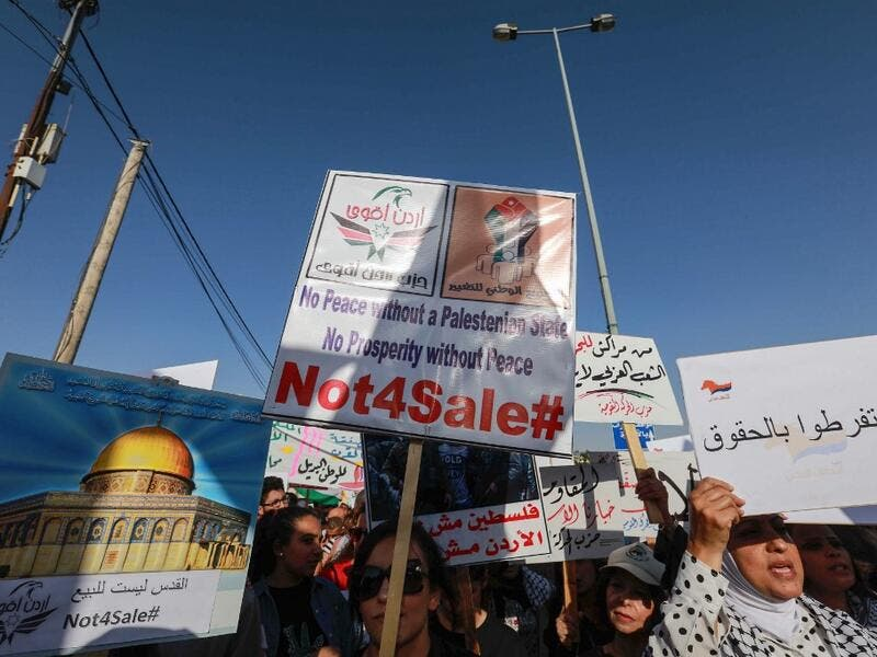 "Protesters march with signs showing the Dome of the Rock and reading in  Arabic (L to R) ""Jerusalem is not for sale"" and ""do not give up rights"" during t he ""March of Anger"" leading to the US Embassy in the Jordanian capital Amman on June 21, 2019. Khalil MAZRAAWI / AFP"