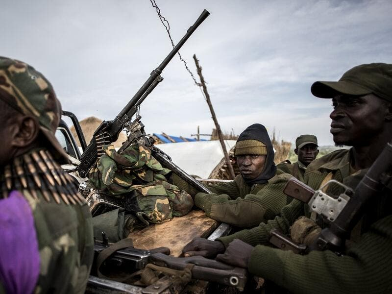 Soldiers of the Armed Forces of the Democratic Republic of the Congo (FARDC) sit in a truck bed in a base on July 3, 2019 in Djugu, eastern DR Congo. John WESSELS / AFP