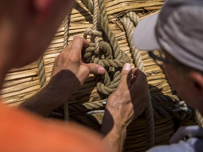 Members of the crew assemble the 14-meter long sailing reed boat Abora IV in the town of Beloslav, Bulgaria, on July 25, 2019. A team of two dozen researchers and volunteers from eight countries are preparing to set out in mid-August on a 1,300 kilometres (700 nautical mailes or 800 miles) journey to test the hypothesis that prehistoric trade routes traversed the high seas. NIKOLAY DOYCHINOV / AFP