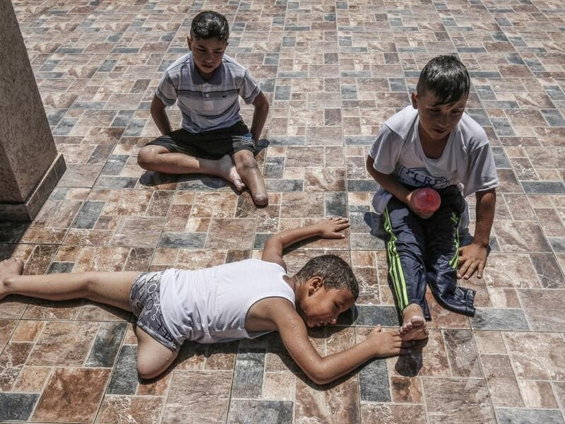 Palestinian amputee children rest during a summer camp origanized by the Palestinian Children's Relief Fund (PCRF) in the town of Khan Yunis in the southern Gaza strip on August 3, 2019. The PCRF is a non-governmental organisation providing physical and psychological services for disabled children in Gaza Strip. SAID KHATIB / AFP